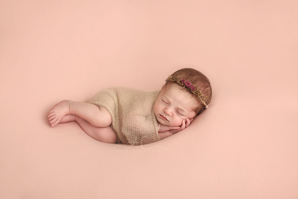 Bromley Newborn Baby Girl Photography | newborn baby girl with flower wreath on her head sleeping peacefully