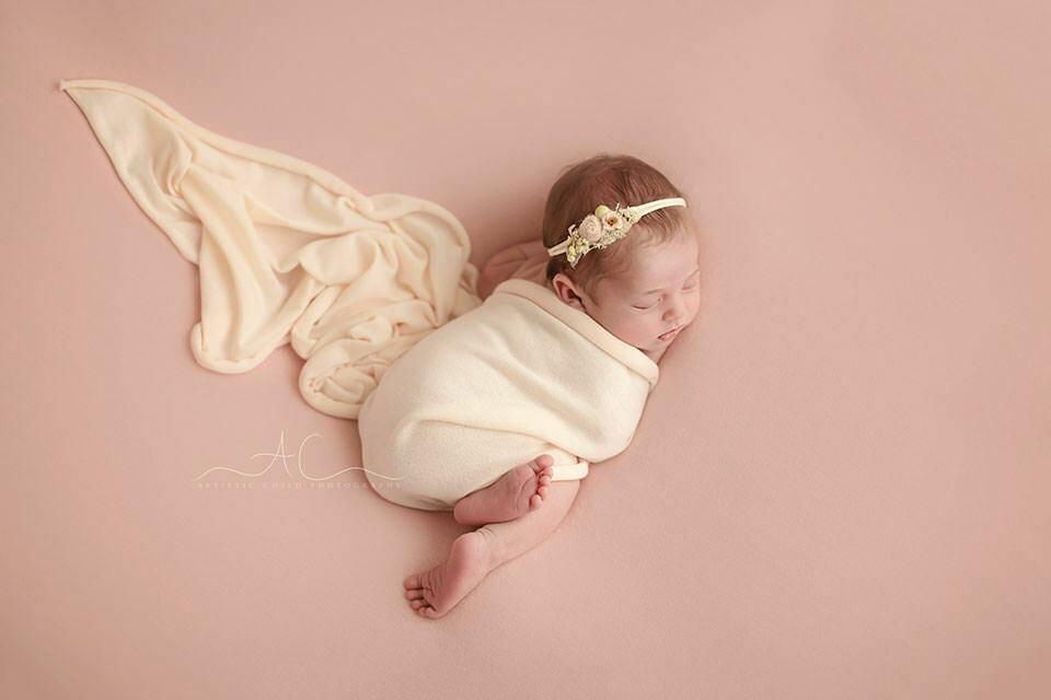 Bromley Newborn Baby Girl Photography   newborn baby girl wearing a flower headband during the newborn photo session