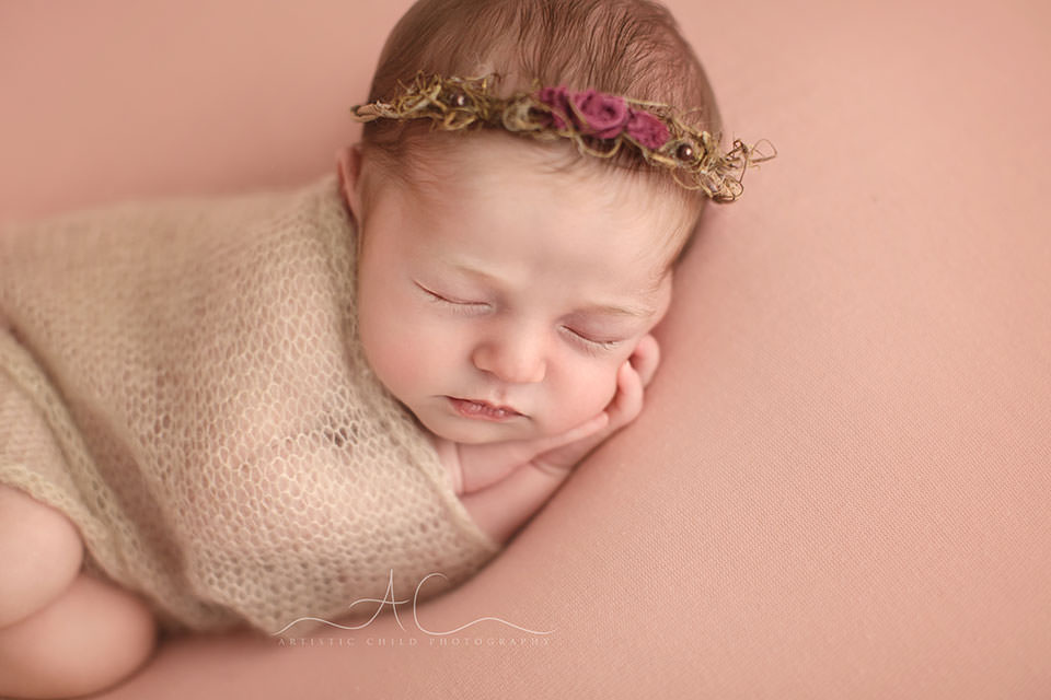 Bromley Newborn Baby Girl Photography   a close up portrait of a newborn baby girl wearing a beautiful flower wreath