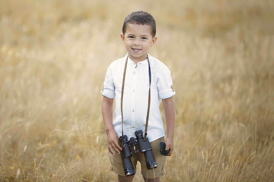 London Children Photography Services | portrait of a 5 year old boy with binoculars