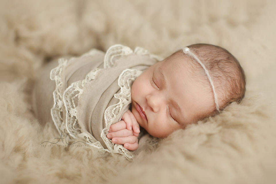 newborn baby girl swaddled in a lace wrap | London