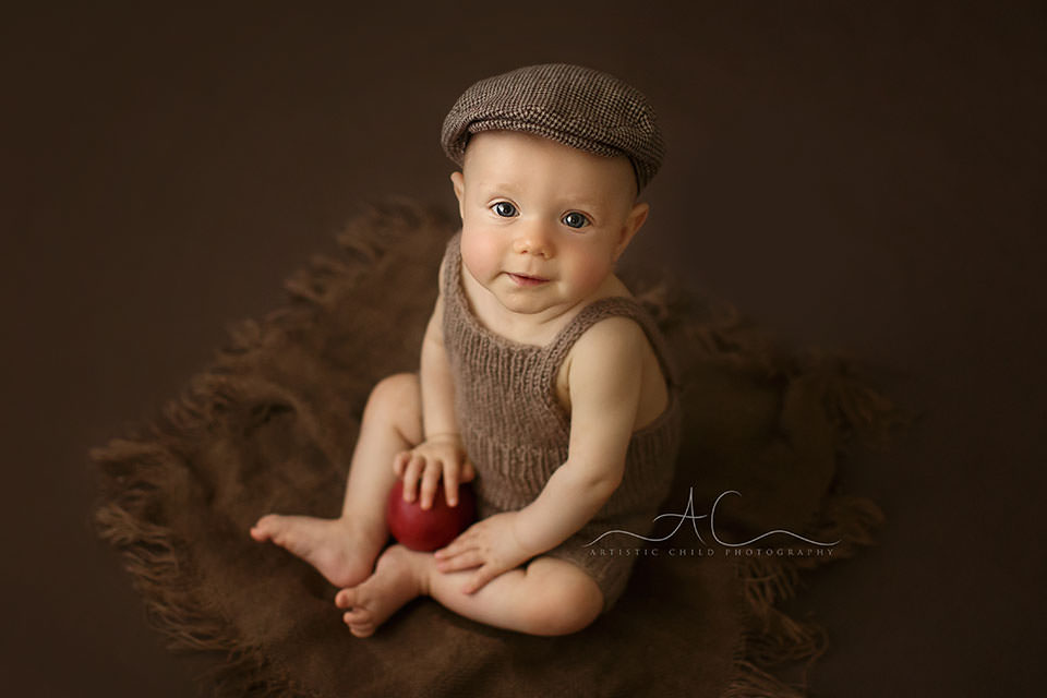 photo of a 6 months old baby boy in a flat cap | London