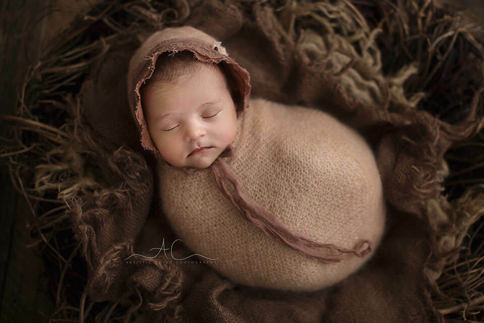 Professional Bromley Newborn Photography | newborn baby girl wearing a beautiful brown bonnet and a hand made wrap