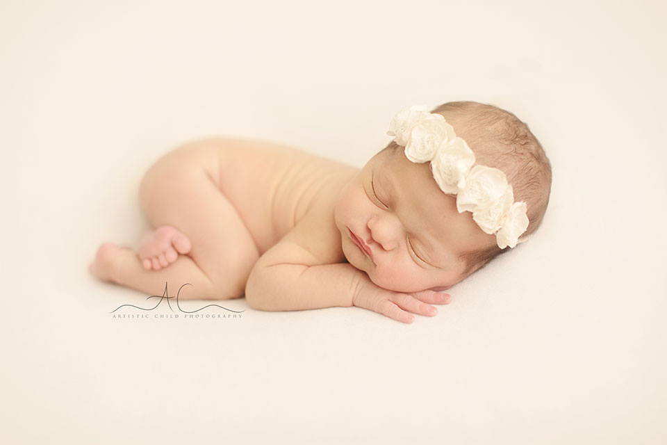 South East London Newborn Baby Girl Photo Session | a newborn baby girl sleeping on her tummy