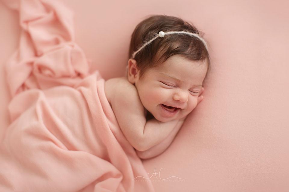 Professional Bromley Newborn Photo Session | newborn baby girl smiling
