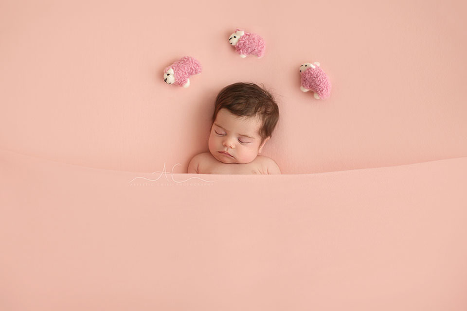 Professional Bromley Newborn Photo Session | newborn baby girl counts sheeps while sleeping during her first photoshoot
