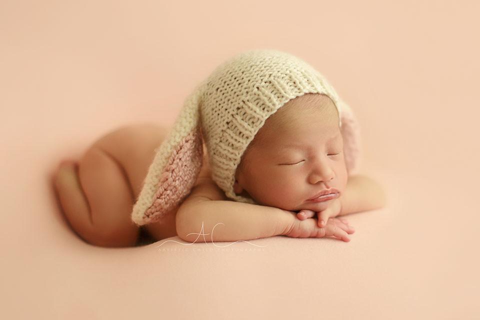 Unique London Newborn Images | newborn baby girl wears a bunny ear hat
