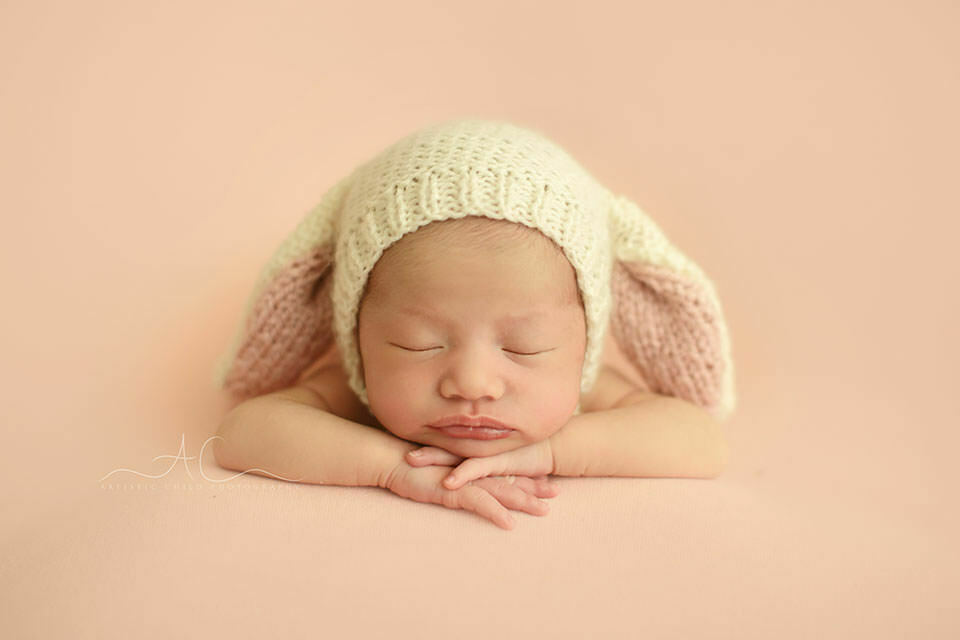 Unique London Newborn Images | a close up portrait of a newborn baby girl wearing a bunny ears hat
