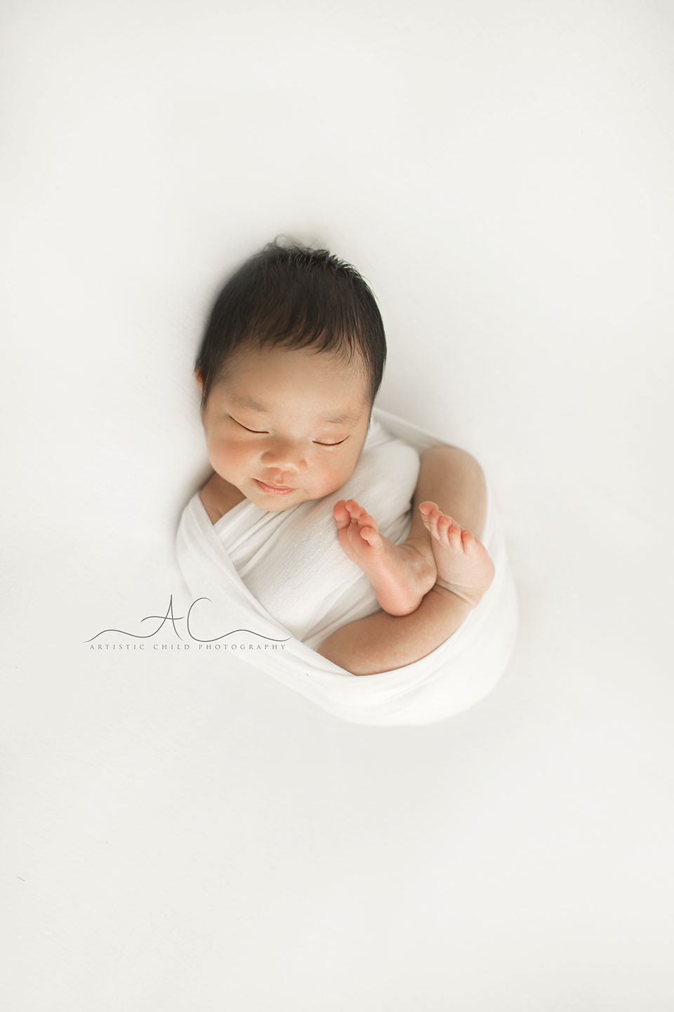 natural portrait of a newborn baby boy photographed on a white backdrop | London