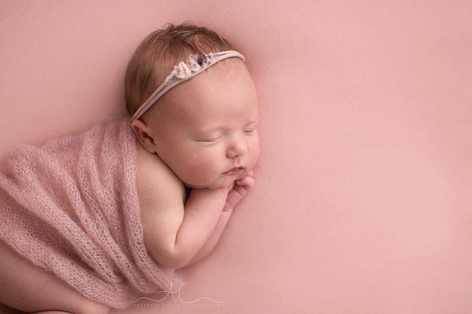 Bromley Newborn Baby Girl Photographer | newborn baby girl sleeping on her side covered by a soft hand knitted wrap