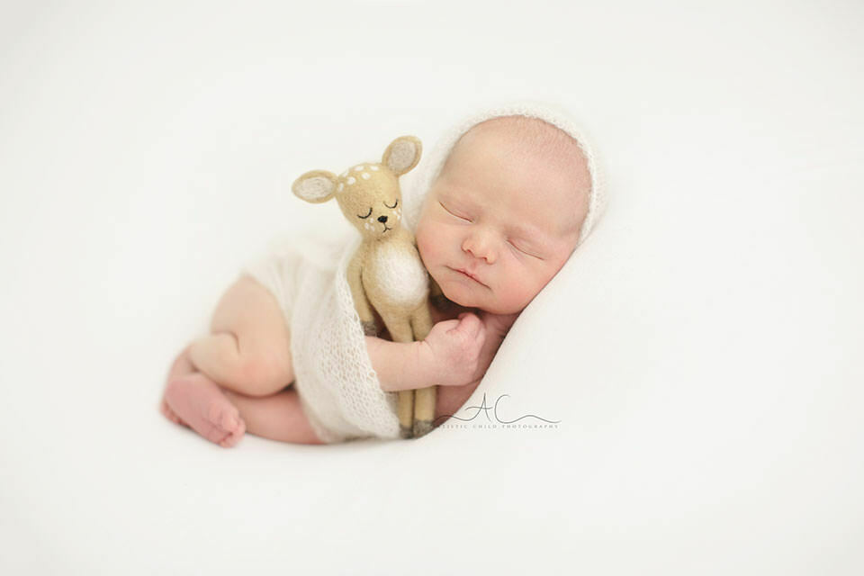 South East London Newborn Baby Boy Photographer | newborn baby boy holds a felted toy while sleeping
