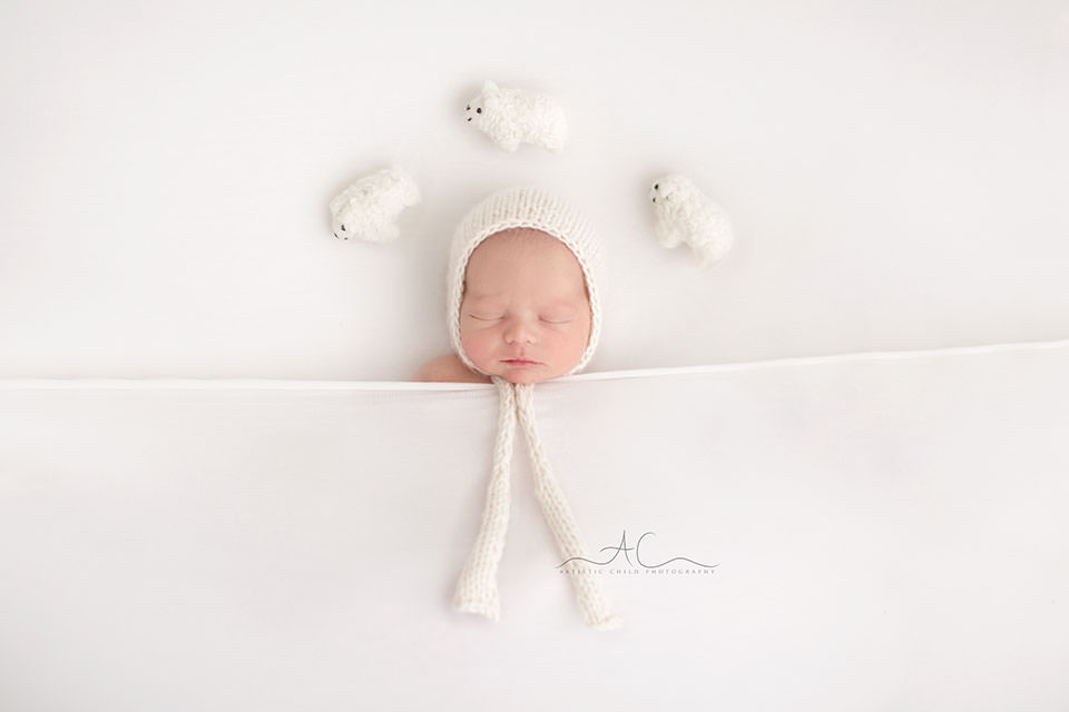 South East London Newborn Baby Boy Photographer | nwborn baby boy counts sheep while sleeping