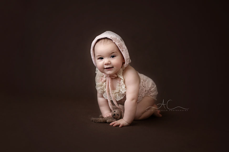 portrait of 8 months old baby girl in a pink bonnet   London