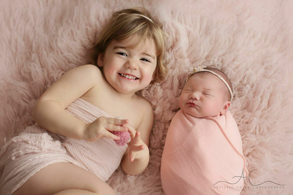 London Sibling Pictures | a portrait of a newborn baby girl and her 3 year old older sister