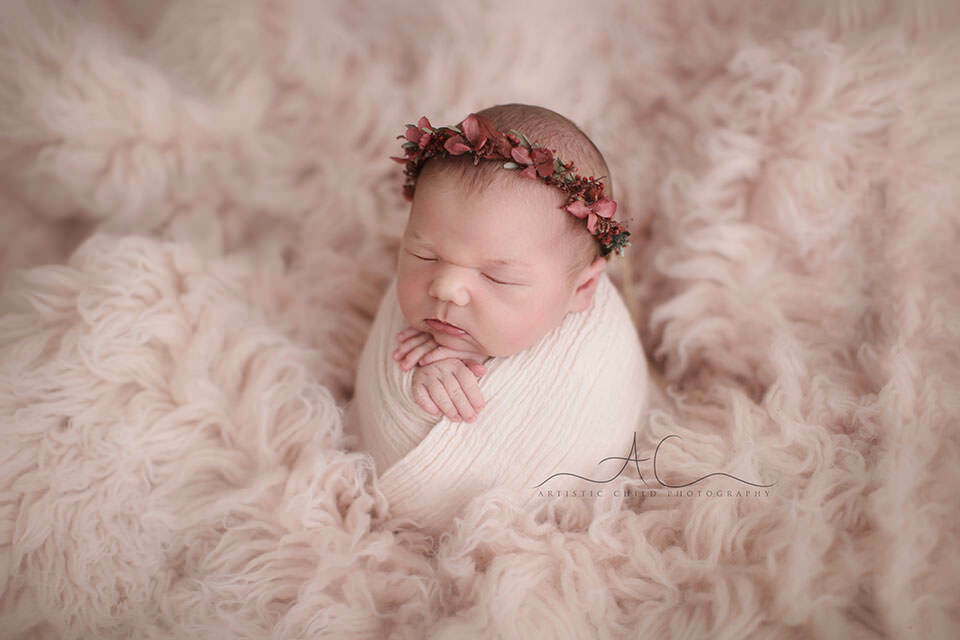 portrait of a newborn baby girl wearing a flower wreath | London