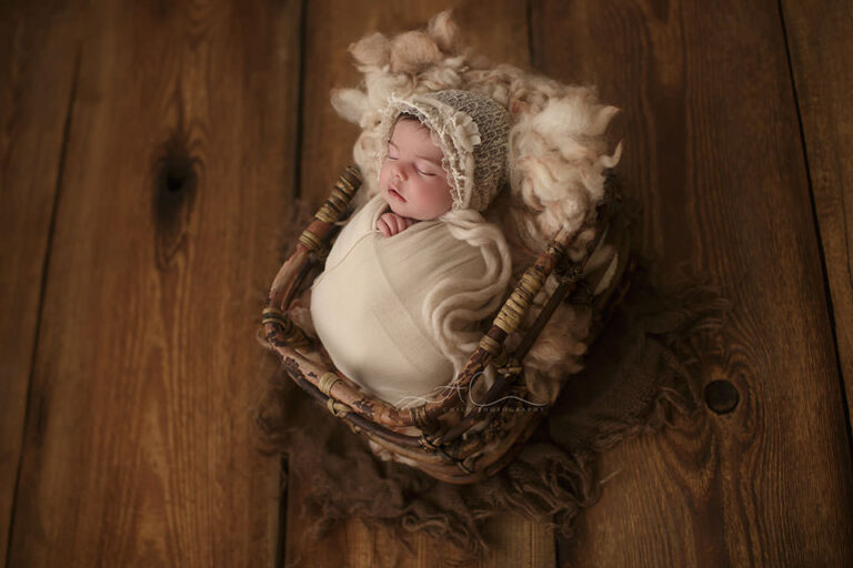 South East London Newborn baby Girl Photography Services | newborn baby girl sleeps in a bamboo basket