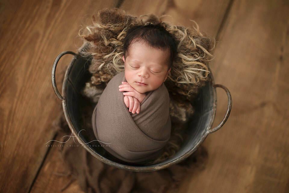 Bromley Newborn Baby Boy Photos | newborn baby boy sleeping in a backet prop during a newborn photo session