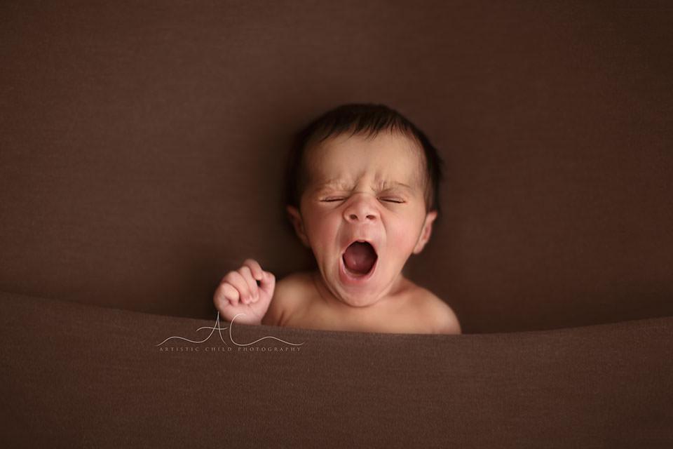 Bromley Newborn Baby Boy Photos | portrait of a newborn baby boy yawning