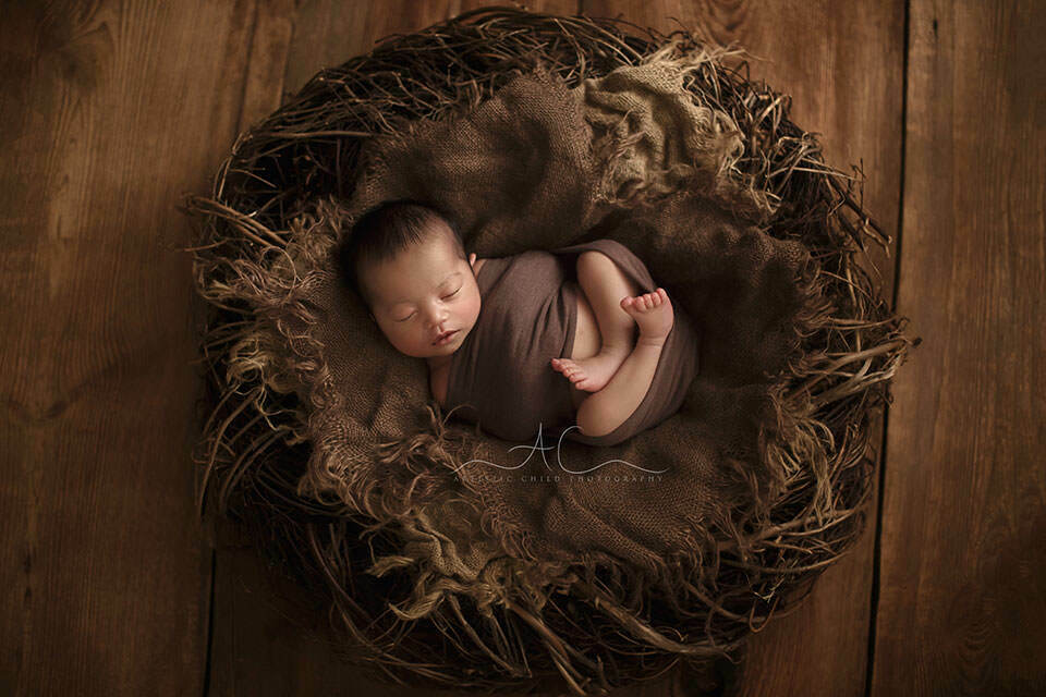 South East London Newborn Baby Boy Photo Session | newborn baby boy sleeps in a hand made real nest