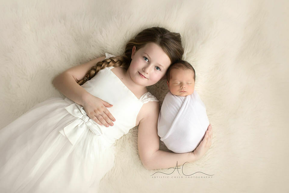 South East London Sibling Pictures | portrait of a newborn baby boy and his 6 year old sister