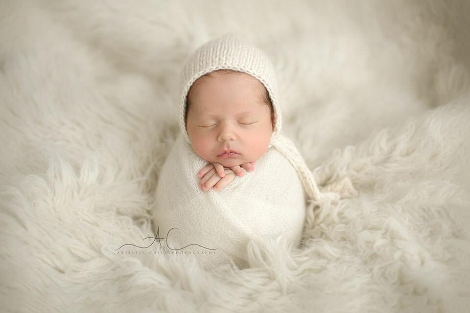 portrait of a swaddled newborn baby boy | London