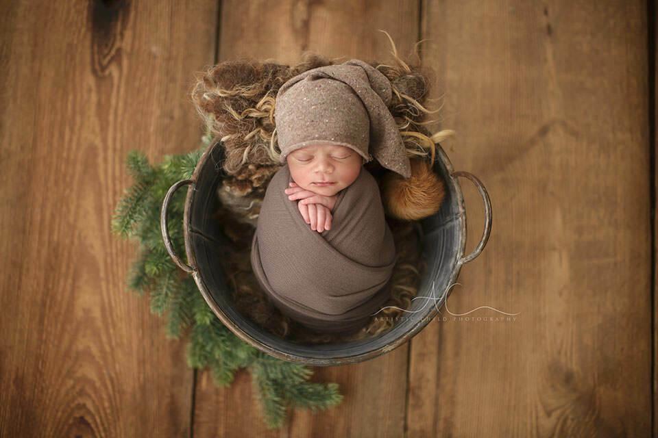 portrait of a newborn baby boy wearing a sleepy hat | London