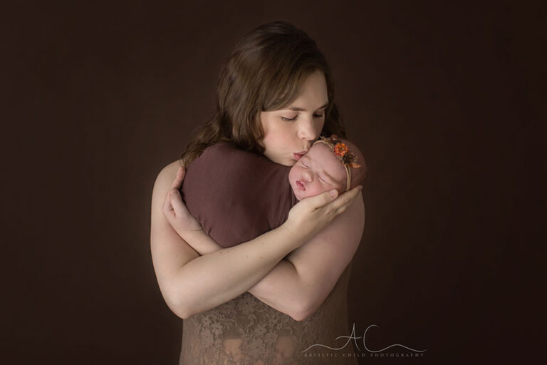 London Family Photography Offer |portrait of a mum kissing her newborn baby daughter