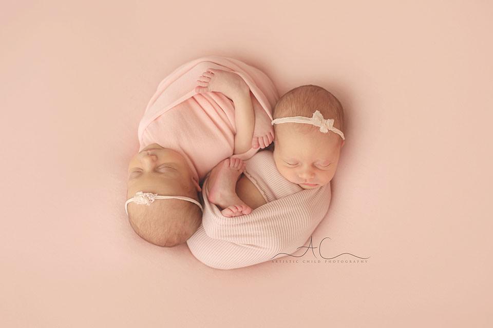 London Newborn Twin Girls Photography | portrait of a twin girls wearing pretty headbands