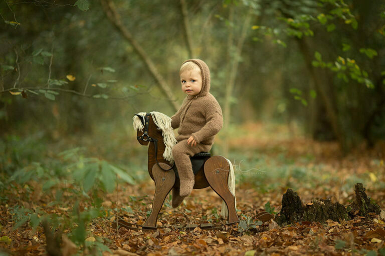 Professional South East London Toddler Pictures   portrait of 15 months old toddler boy sitting on a wooden rocking horse