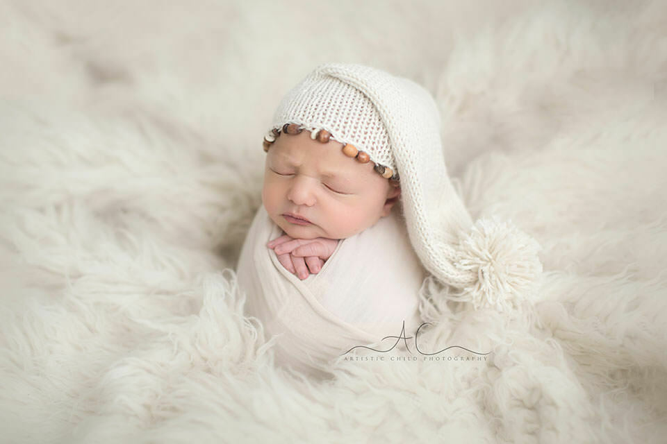 South East London Newborn Baby Boy Photography Offer | portrait of a newborn baby boy wearing a white sleepy hat