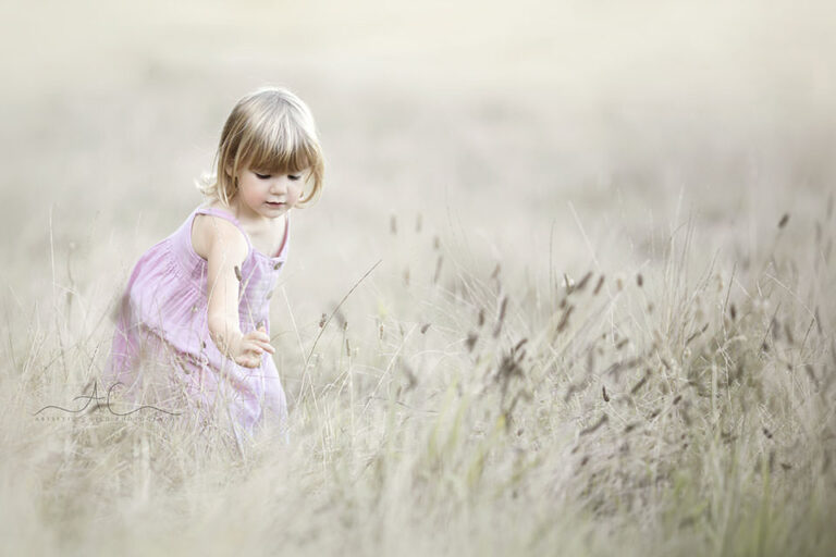 London Kids Pictures | 3 year old girl picking flowers in the field of grass