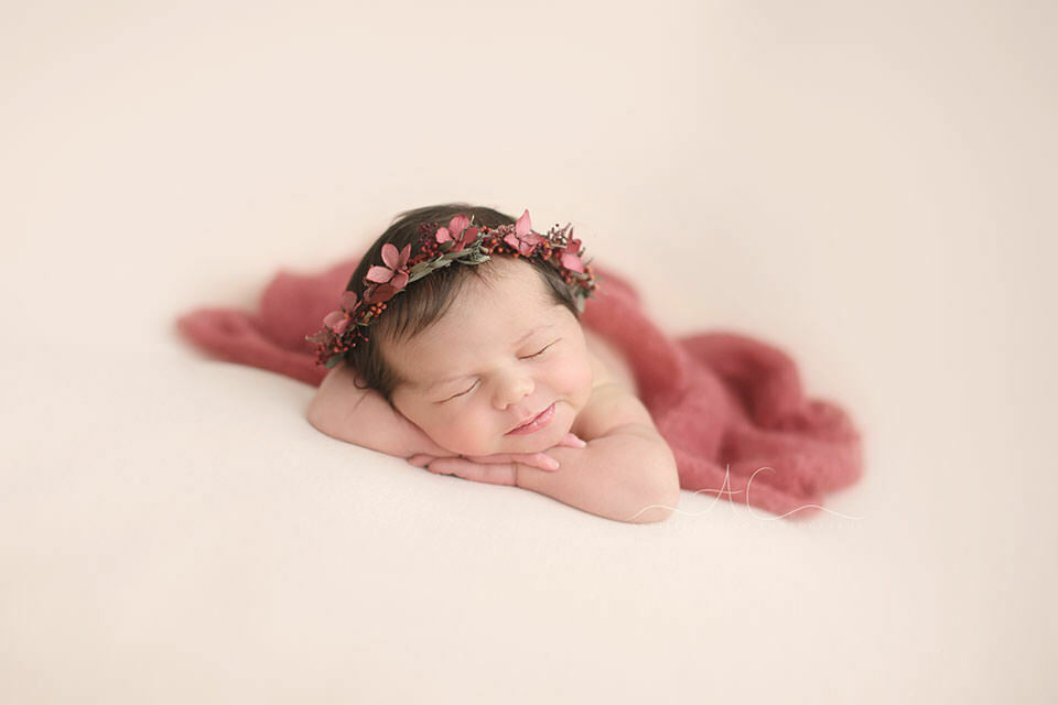 Professional Bromley Newborn Baby Photo Session | photo of a newborn baby girl posed in chin on hands pose