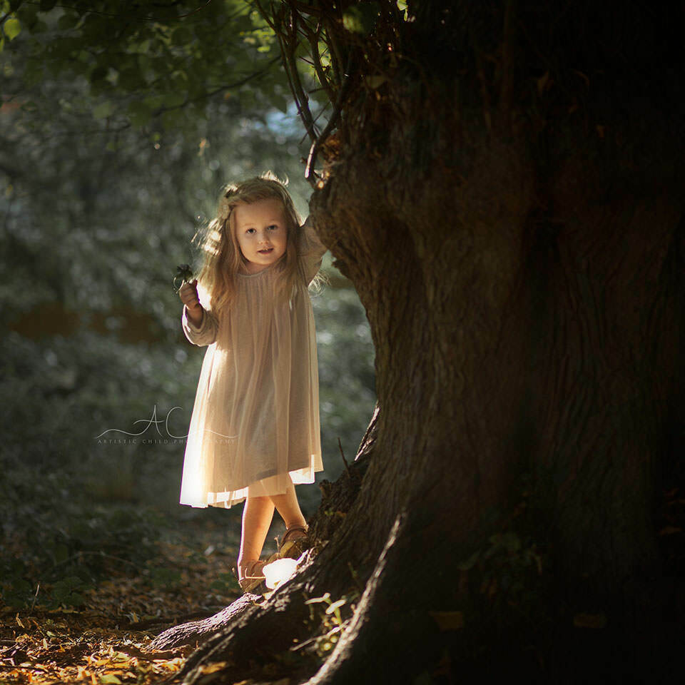 South East London Kids Photographer | beaitifully backlit portrait of a 3 year old girl standing under the tree