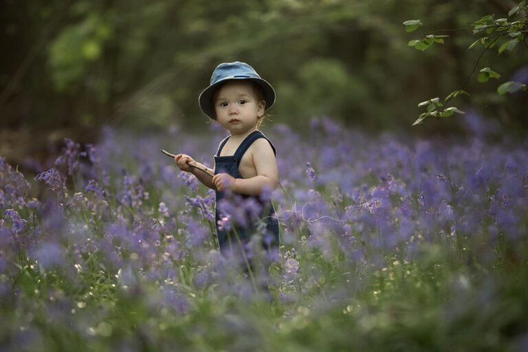 Bluebells London Toddler Photography   beautifully backlit portrait of a 1 year old standing in the bluebells field