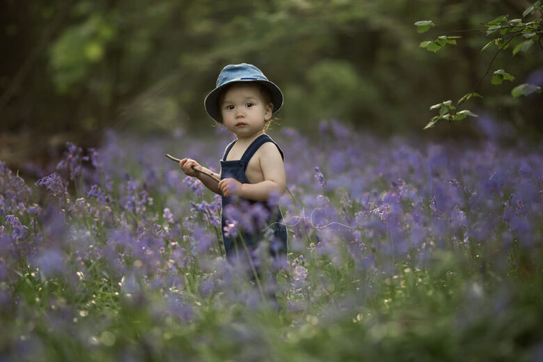 Bluebells London Toddler Photography | beautifully backlit portrait of a 1 year old standing in the bluebells field