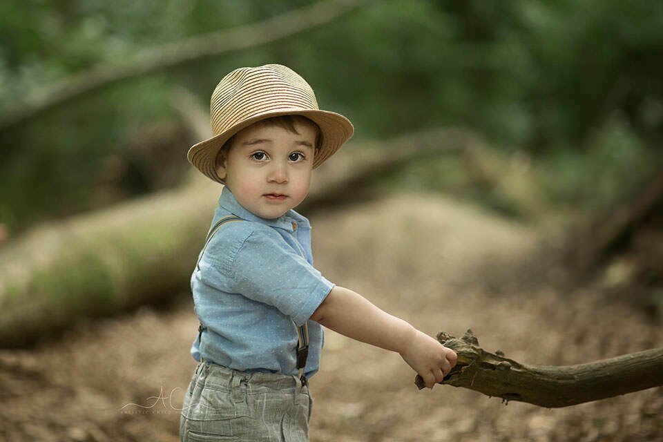 photo of a toddler boy with a hat | London
