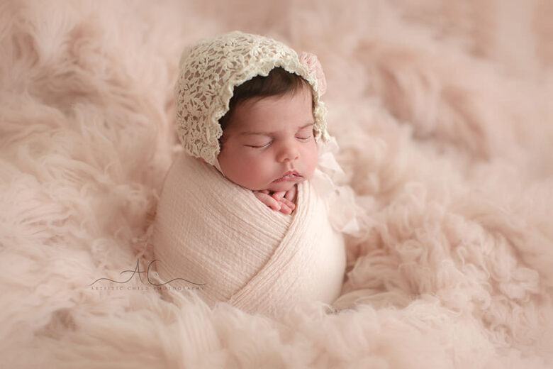Professional Bromley Newborn Baby Photographer | photo of a newborn baby girl taken on a pink flokati
