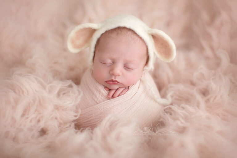 Professional Bromley Newborn Baby Pictures | portrait of a newborn baby girl wearing a cute sheep ear hat