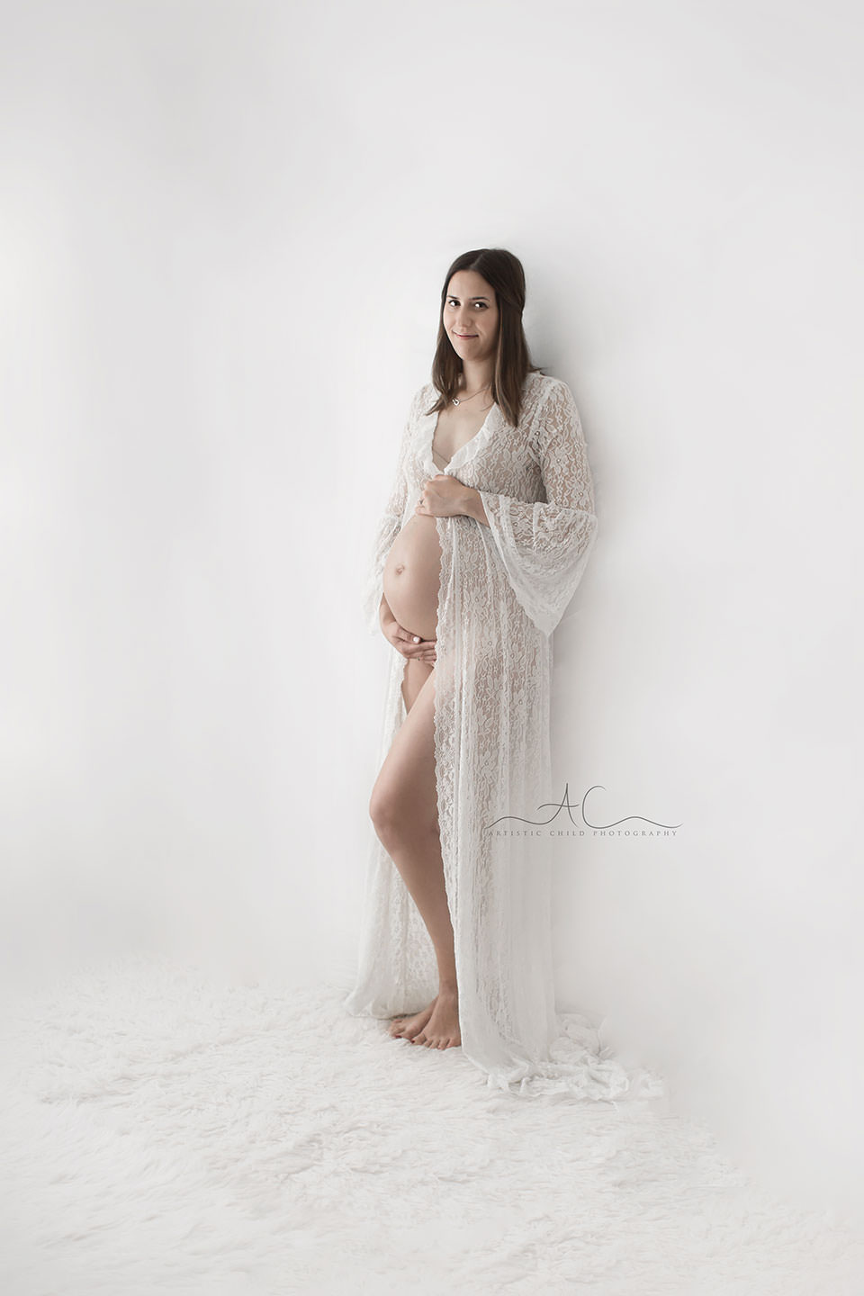 beautiful maternity image of a  woman wearing a lace pregnancy gown | Bromley