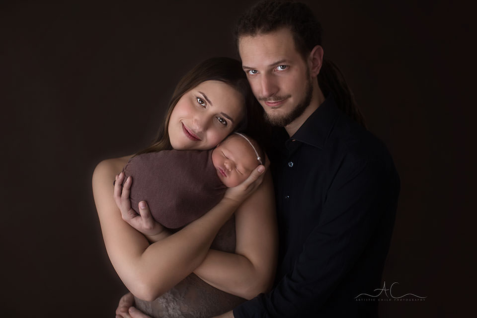 image of parents and their newborn baby girl taken during a newborn photo session | South East London