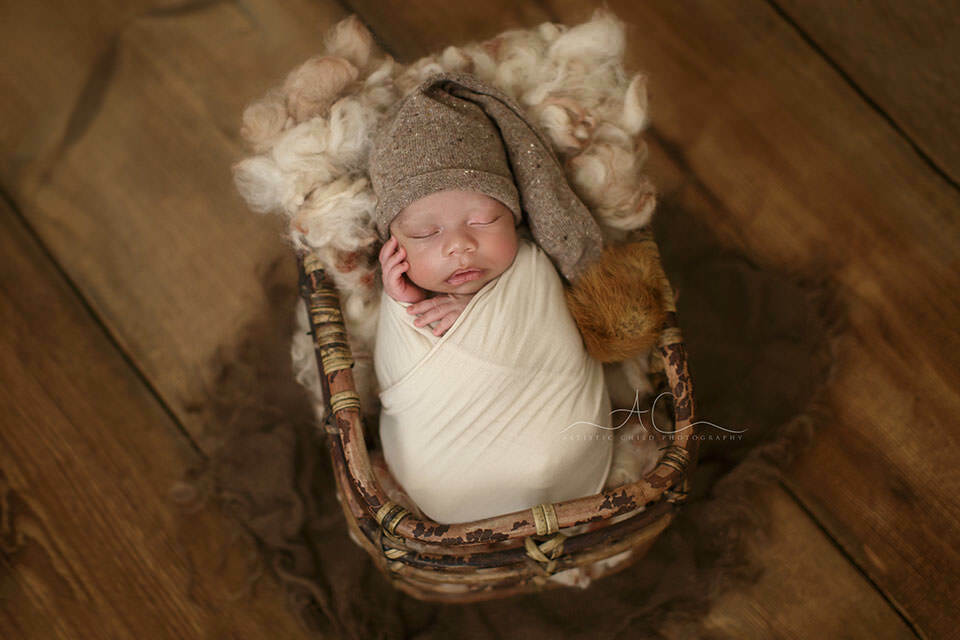 newbron baby boy in a sleepy hat | London