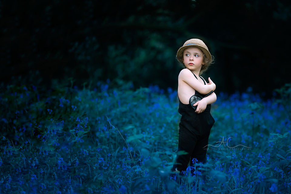 Best Bluebells London Children Photos | portrait of a 4 year old boy with a hat taken in bluebells