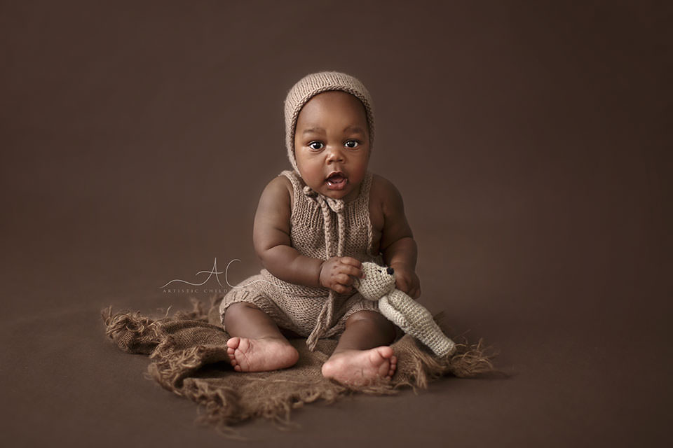 7 months old baby boy plays with a tiny teddy  during a professional photoshoot | South East London