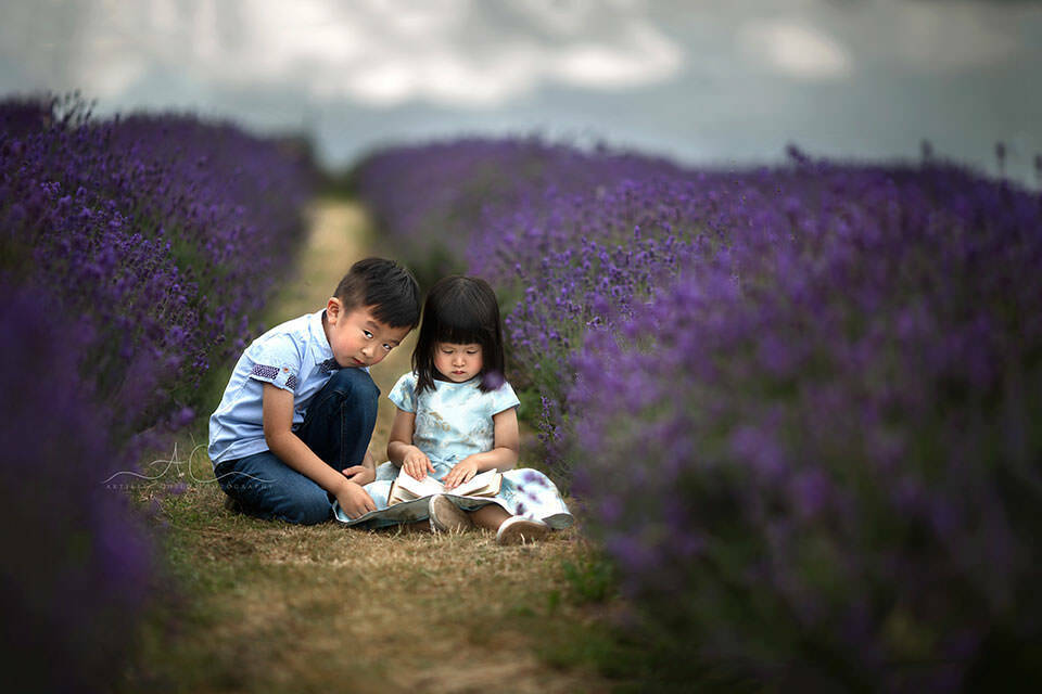 brother and sister reading a book in Mayfield avender field | London