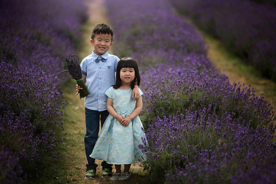 portrait of an older brother and his younger sister taken in Mayfield Lavender Field | London