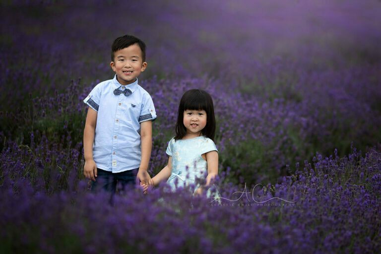 London Sibling Photography in Lavender Field | borther and sister holding hands in lavender field