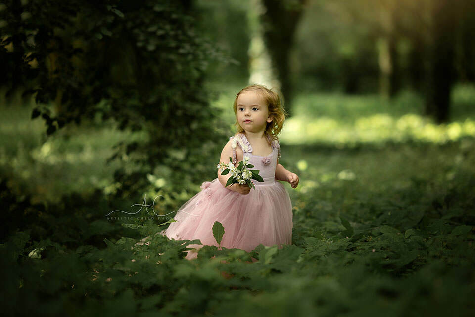 portrait of running away 3 years old girl dressed up as a princess | London