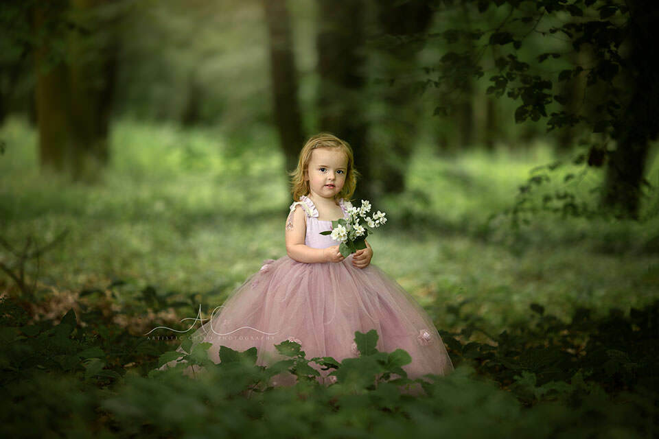 Princess Photo Session in London   portrait of princess Ina in a beaitiful pink dress holding bunch of white flowers