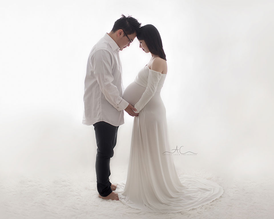 South East London Maternity Photography | a full body backlit portrait of future parents
