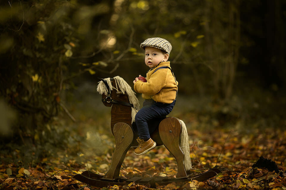 Autumn South East London Toddler Photoshoot | outdoor portrait of 15 months old boy sitting on a rocking horse